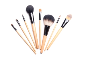 brown make-up brushes isolated on white background
